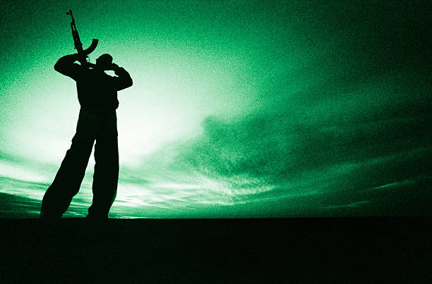 night vision | armed fighter stock photo