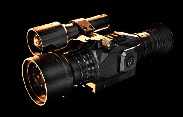 Nachtsicht-Gewehrkop mit orangefarbener Hintergrundbeleuchtung – Foto