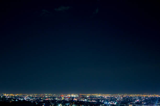 Night wide shot of Monterrey city, in Nuevo Leon, Mexico. Night wide shot of Monterrey city, in Nuevo Leon, Mexico. The center of the city is displayed in this image. vanishing point stock pictures, royalty-free photos & images