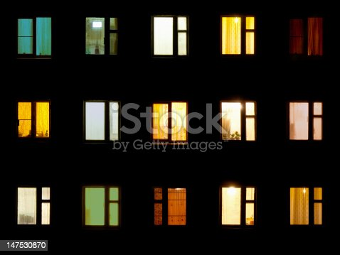 istock Night windows - block of flats background 147530870