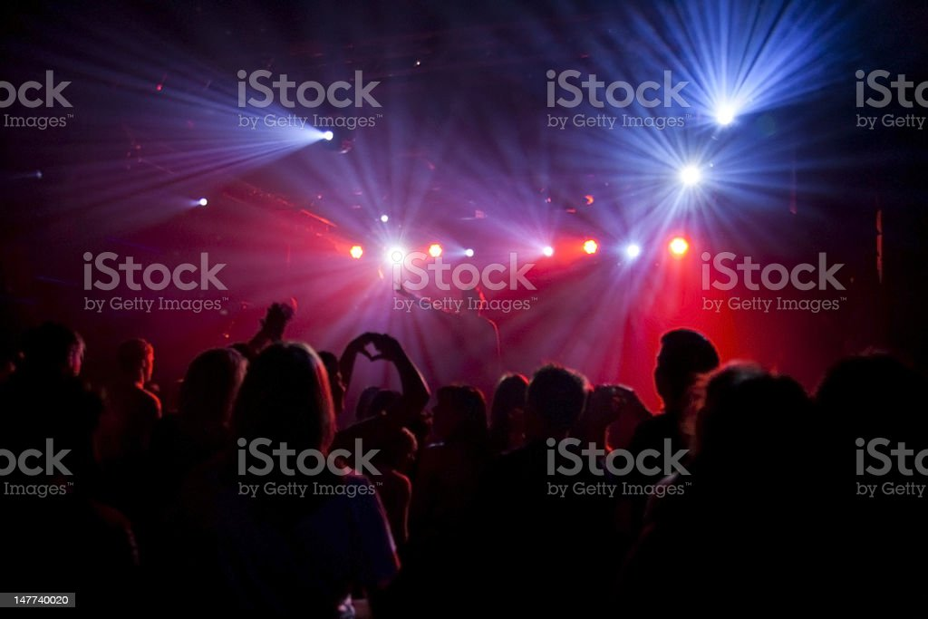 Nightclub lights and silhouette of a party crowd royalty-free stock photo