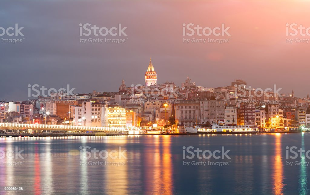 Nighte cityscape with Galata Tower over the Golden Horn in stock photo