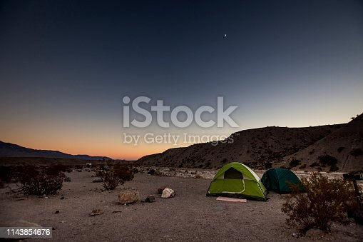 Situated in a deeper part of Death Valley National Park, Mesquite Springs Campground offers solitude, peace, and dark, dark night skies. The dusk offers amazing silhouette, with near-half moon illuminating the early evening.