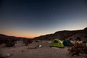 Midnight Explorer illuminating Badwater Basin in Death Valley at night. California. United States of America