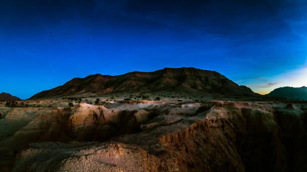 Nightfall on strange desert canyon landscape stock photo