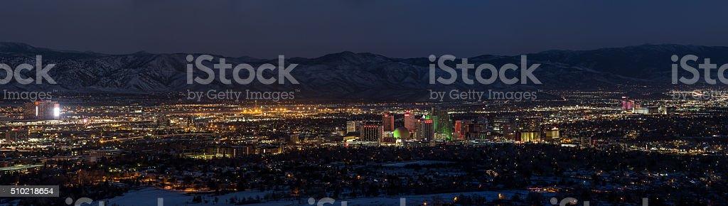 Nightime panorama of Reno, Nevada stock photo