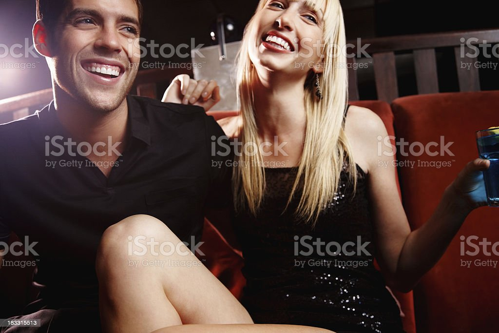 Nightlife - Cheerful couple enjoying a party together royalty-free stock photo