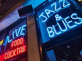 Chicago, Illinois USA. May 10, 2019.  Nightlife with Jazz and Blues music. Retro bar with red and blue neon sign. Food and coctails