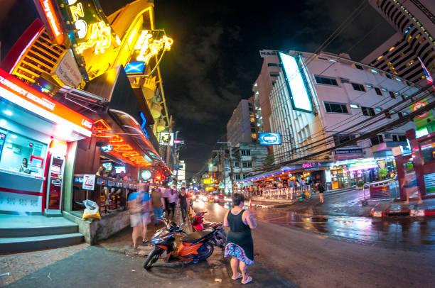 nightlife in soi 4, bangkok, thailand - motorbike, umbrella stock photos and pictures