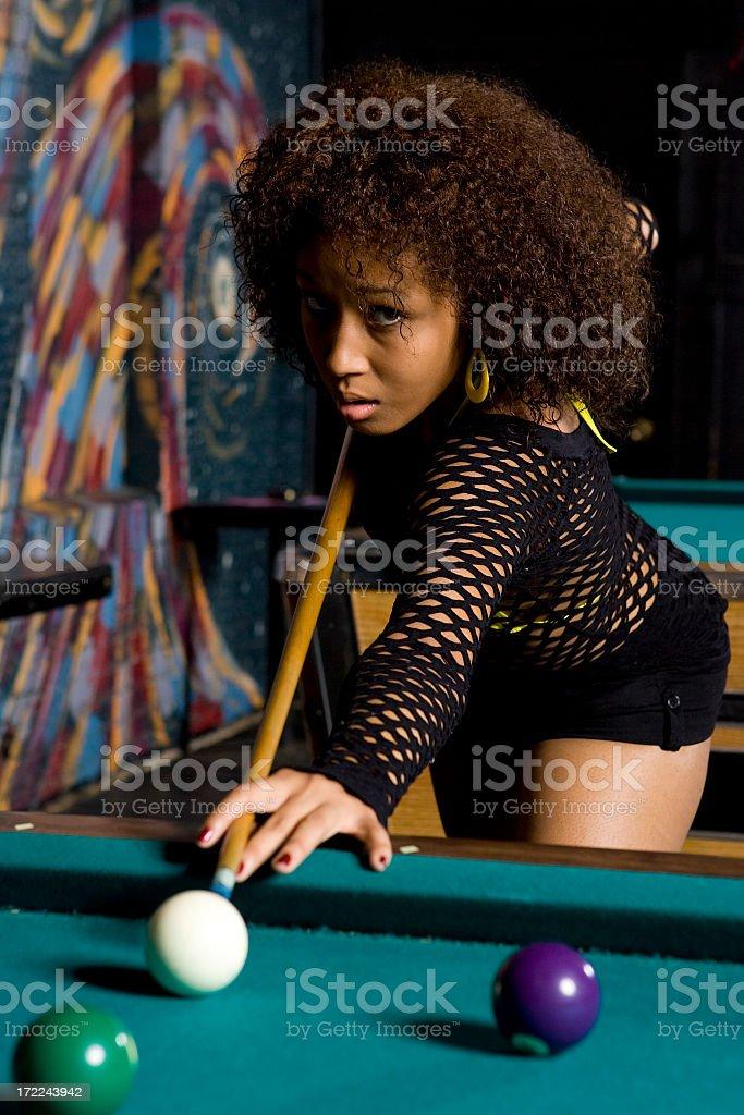 Nightlife Series-African American Girl Playing Billards stock photo