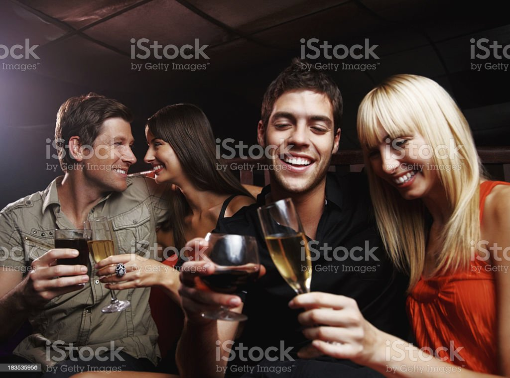 Nightlife - Two couples celebrating together at a party royalty-free stock photo