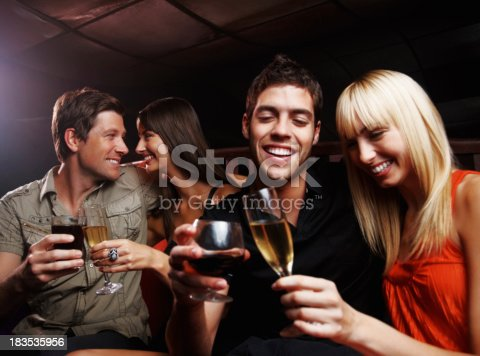 istock Nightlife - Two couples celebrating together at a party 183535956