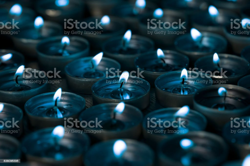 Nightlight. Lighted tea light candles at night with a silver blue tone. stock photo