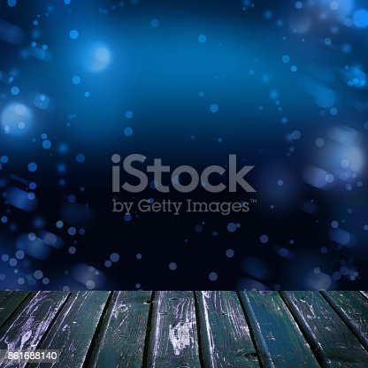 istock Nightly Background with Empty Wooden Deck Table with Bokeh and Blue Night Sky 861688140