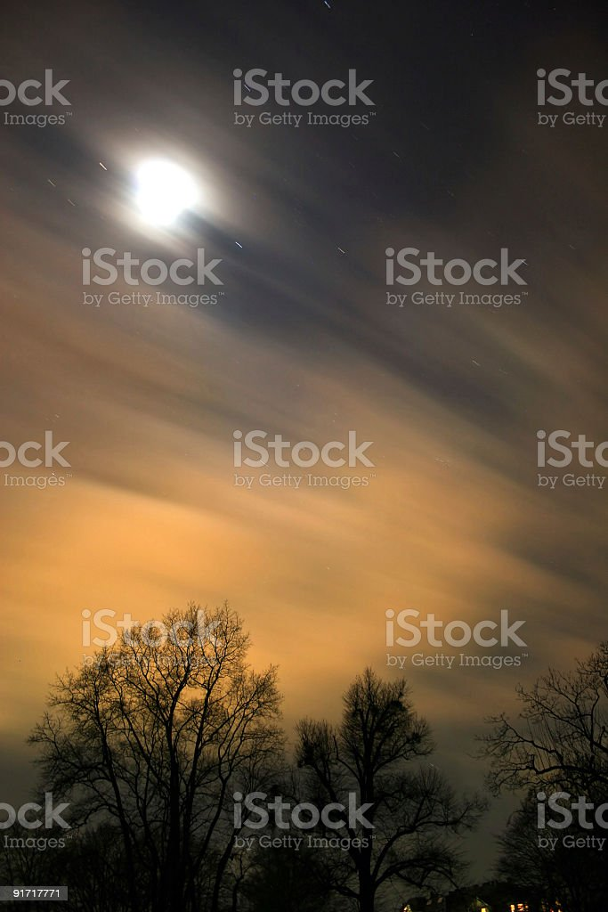 Nightly sky - time exposure photo with moon and clouds royalty-free stock photo