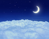 Nightly sky with moon, cloud and stars.