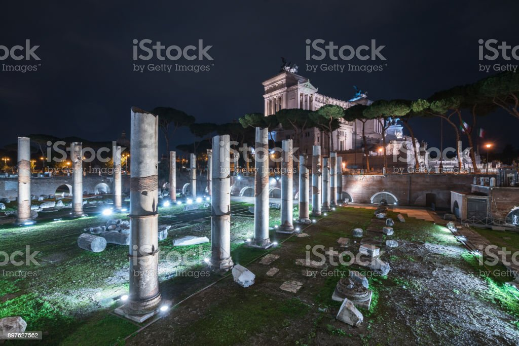 Nightly view of the Basilica Ulpia in Rome, Italy stock photo