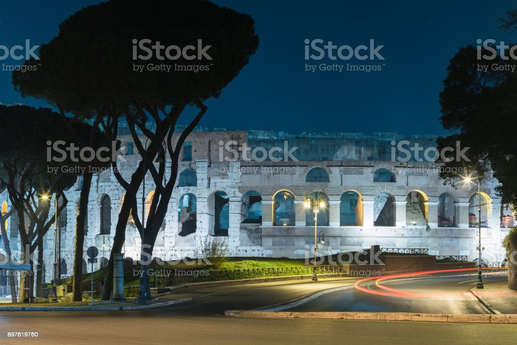 Nightly view upon the  Colosseum from the side of the  Via di San Gregorio street stock photo