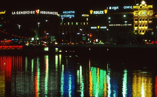 Nightscape along waterfront in downtown Geneva Switzerland Europe and reflection on Lake Geneva