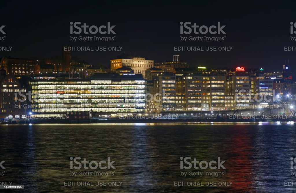 Nightscape of central Stockholm. Old buildings, sea and construction cranes stock photo