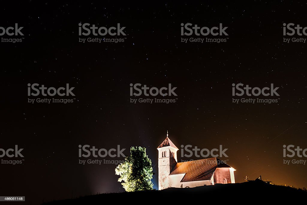 Nightscape with church and ursa major stars stock photo