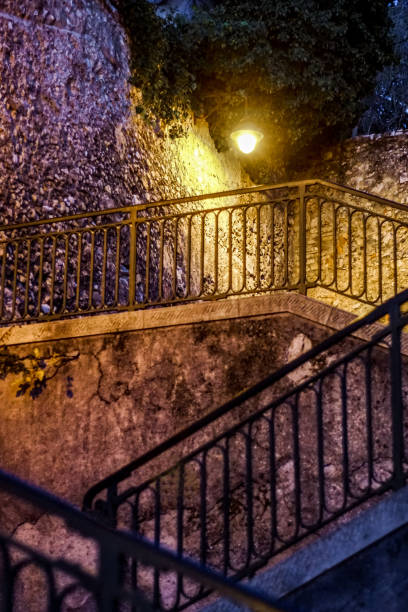 Nightshot of a flight of stairs in the old village of Nice Nightshot of a flight of stairs in the old village (vielle ville) of Nice/France leading to the colline du chateau ville stock pictures, royalty-free photos & images