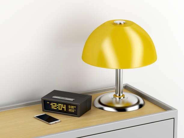 nachttisch mit elektrischen geräten drauf - telefonschrank stock-fotos und bilder