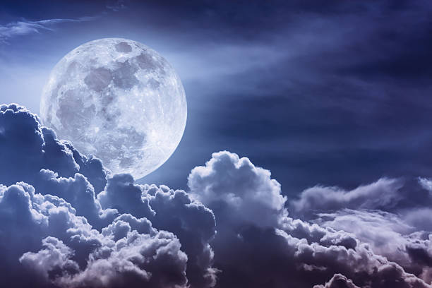nighttime sky with clouds and bright full moon with shiny. - 月 ストックフォトと画像