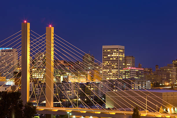 Nighttime skyline bridge view on Tacoma, Washington Bridge in Tacoma Washington at Night with Skyline tacoma stock pictures, royalty-free photos & images
