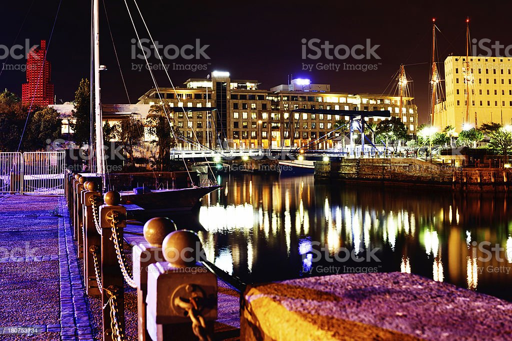 Nighttime walkway next to Cape Town's Victoria and Alfred Waterfront stock photo