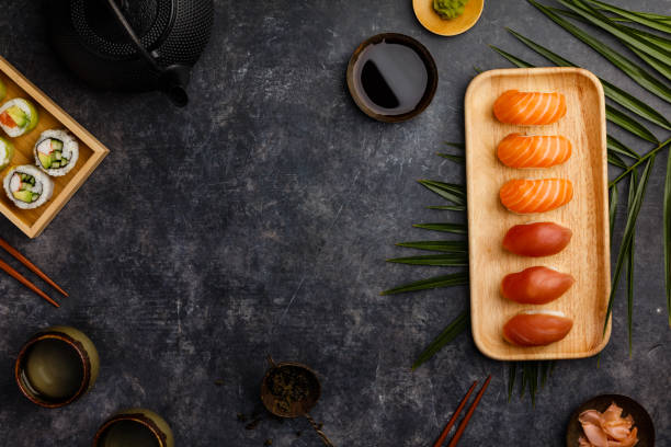 Nigiri sushi set with salmon and tuna served on bamboo plate stock photo
