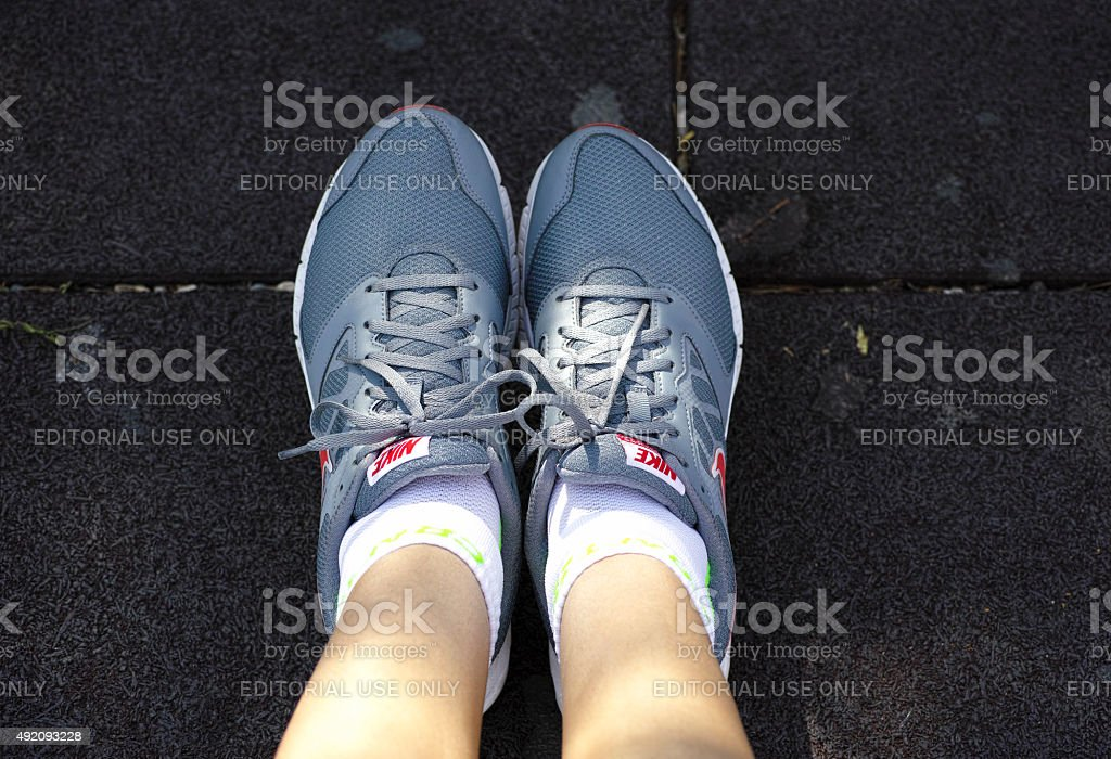 Nike Downshifter running shoes on woman feet stock photo