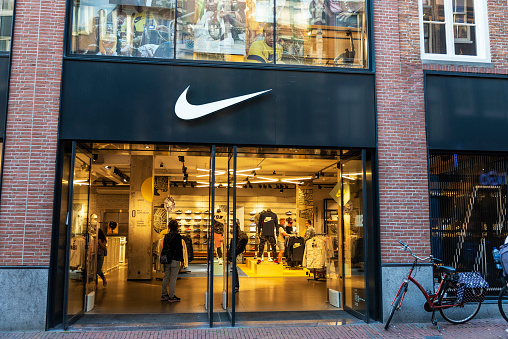 Amsterdam, Netherlands - September 9, 2018: Display of a Nike sports store with people around in Amsterdam, Netherlands