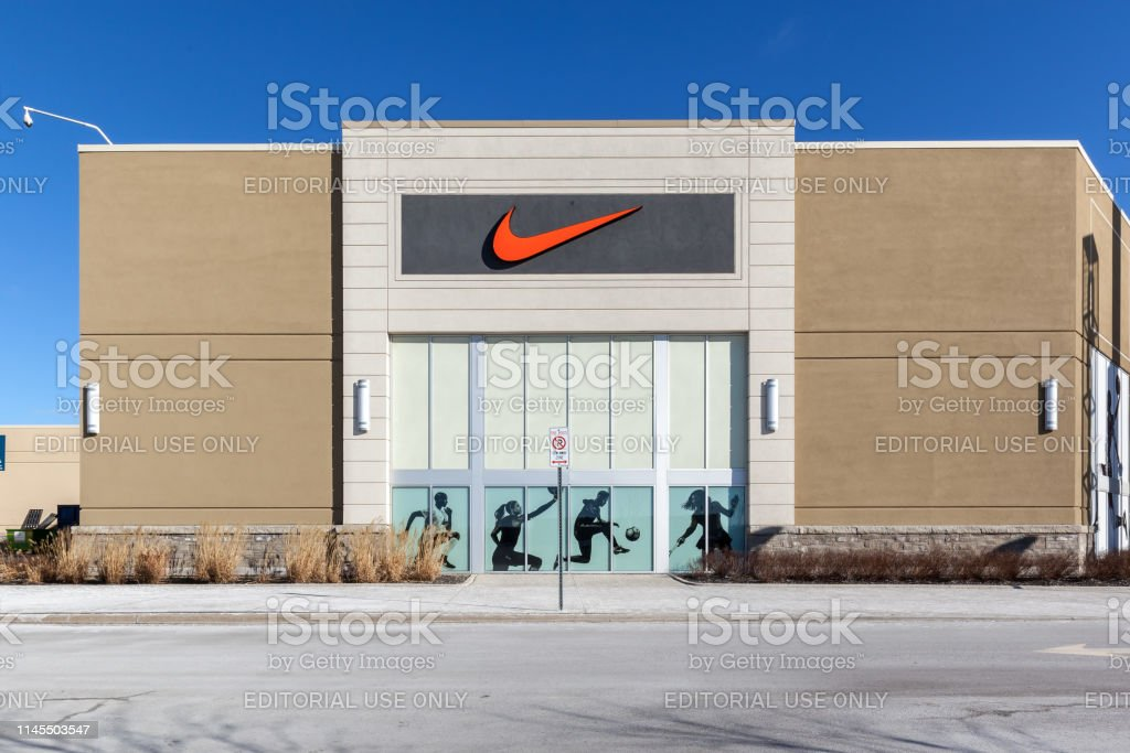 Nike store sign at Vaughan Mills mall near Toronto. Vaughan, Ontario, Canada - March 17, 2018: Nike store sign at Vaughan Mills mall near Toronto. Nike, Inc. is an American corporation sales of footwear, apparel, equipment, accessories, and services. Advertisement Stock Photo