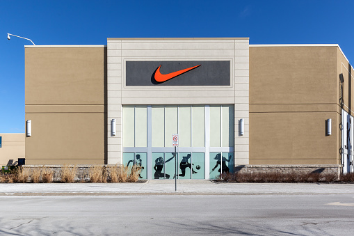 Vaughan, Ontario, Canada - March 17, 2018: Nike store sign at Vaughan Mills mall near Toronto. Nike, Inc. is an American corporation sales of footwear, apparel, equipment, accessories, and services.
