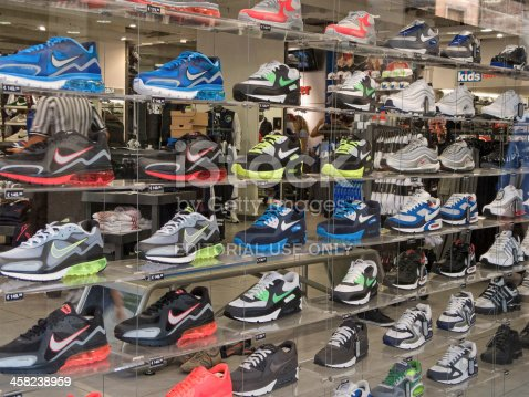 Padua, Italy - September 24, 2011: Shop window of the Foot Locker shop in Padua with different Nike brand shoes on shelves. Foot Locker Inc. is an American sportswear retailer with shops in about 20 countries and known all over the world. Shot from outside the Foot Locker shop of Padua, Italy, along Via Altinate.