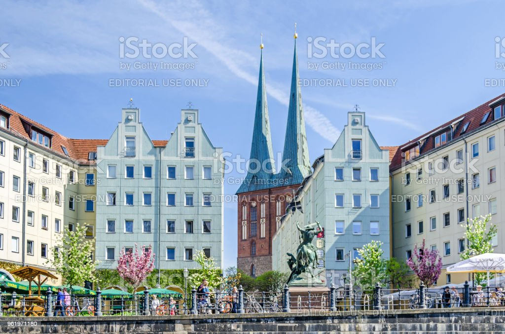 Nikolaiviertel  (Nicholas' Quarter) with historic houses, Nikolaikirche,  skulpture of St.George and its famous traditional German restaurants stock photo