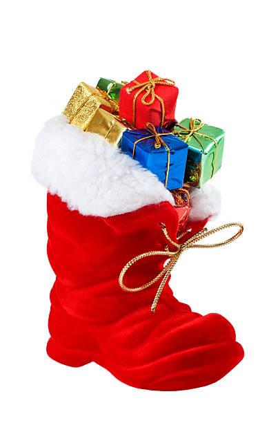 nikolausstiefel mit geschenken - nikolausstiefel stock-fotos und bilder