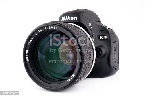 Chiang Mai, Thailand - May 3, 2011: Nikon D5100 DLSR camera with an older manual focus 85mm f1.4 lens.  This image demonstrates how old lenses can be used with modern Nikon camera bodies.