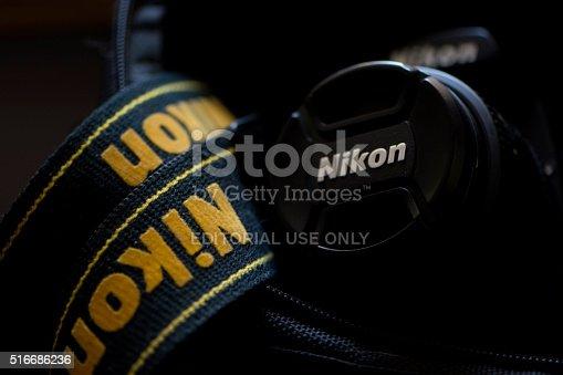 Zhenjiang, China - March 20, 2016: A Nikon camera with Nikon strap in a black bag. Editorial photo taken in Zhenjiang City, Jiangsu Province, China.