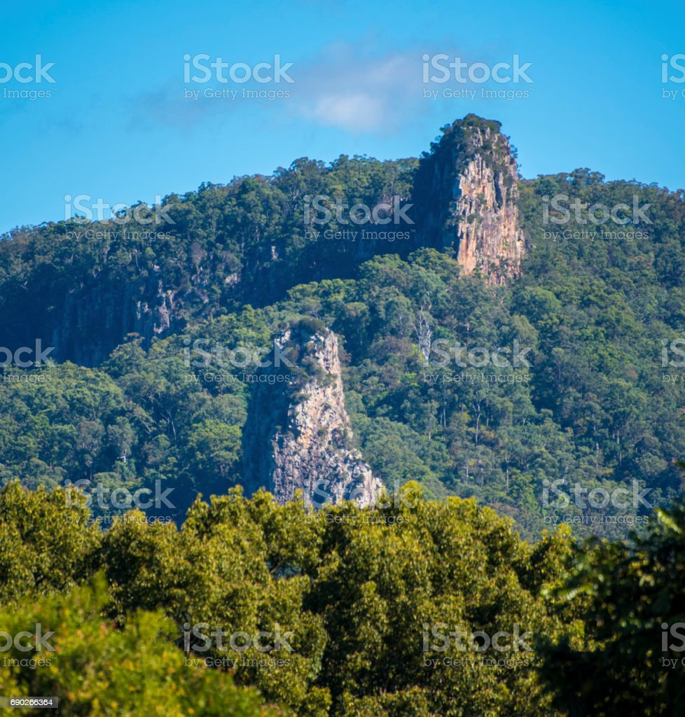 Nimbin Rocks, Nimbin Australia. Ancient volcanic Cores in Morning sun. stock photo