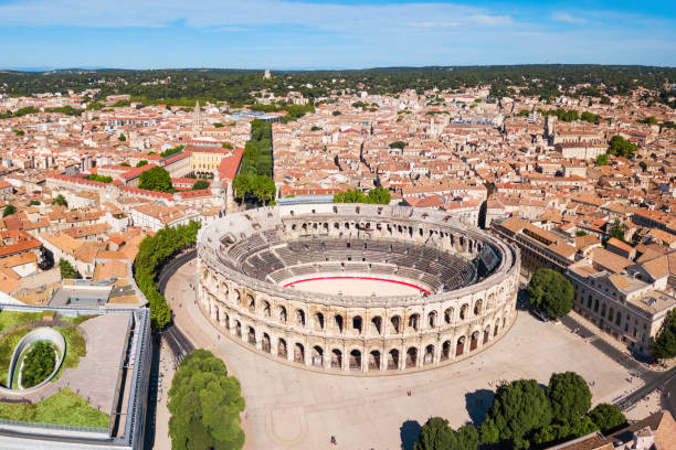 Nimes Arena aerial view, France Nimes Arena aerial panoramic view. Nimes is a city in the Occitanie region of southern France amphitheater stock pictures, royalty-free photos & images