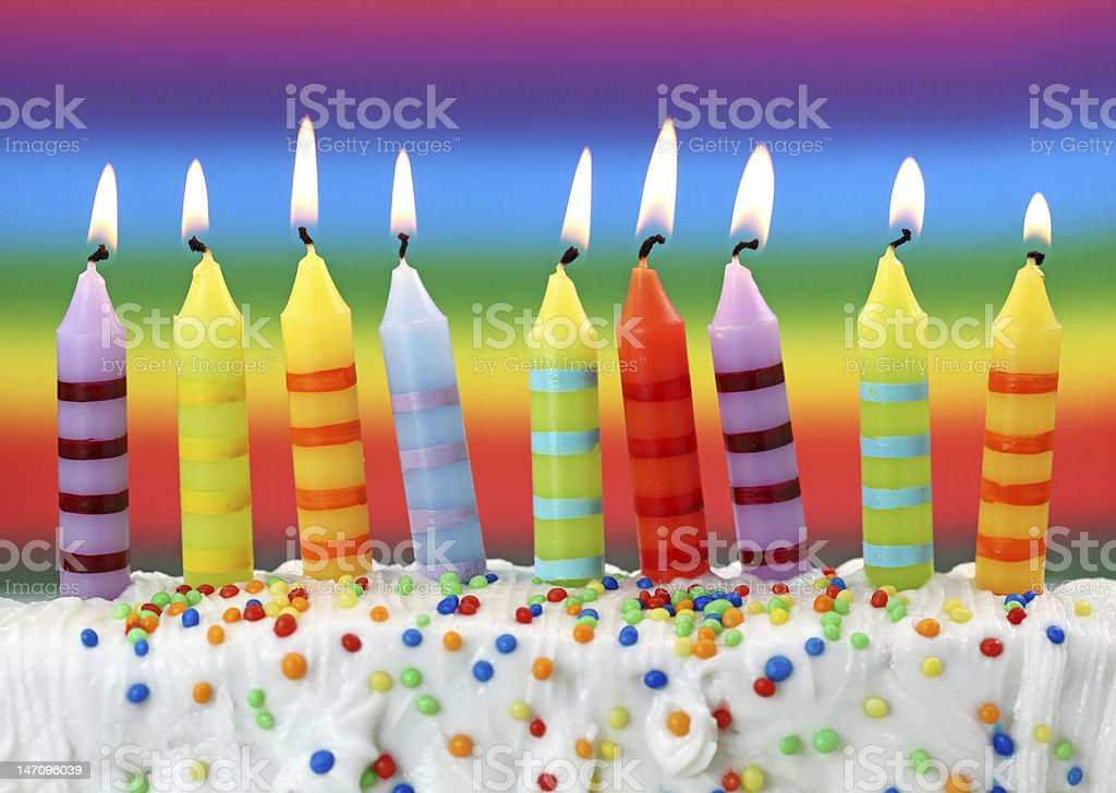 Nine birthday candles on colorful stock photo