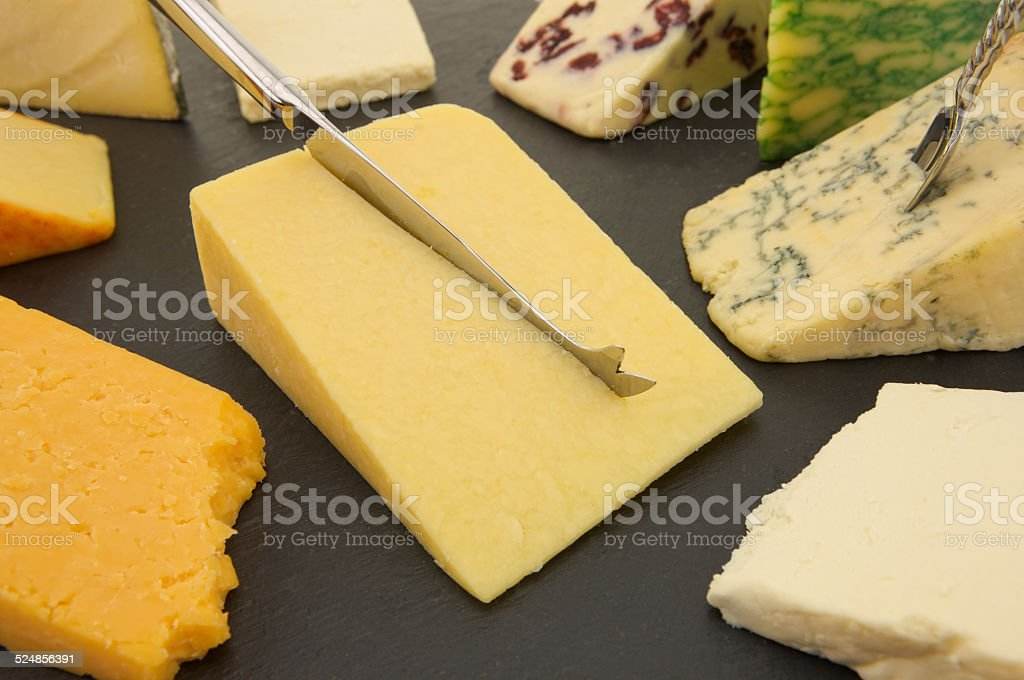 Nine different varieties of British Cheese on a Slate board stock photo