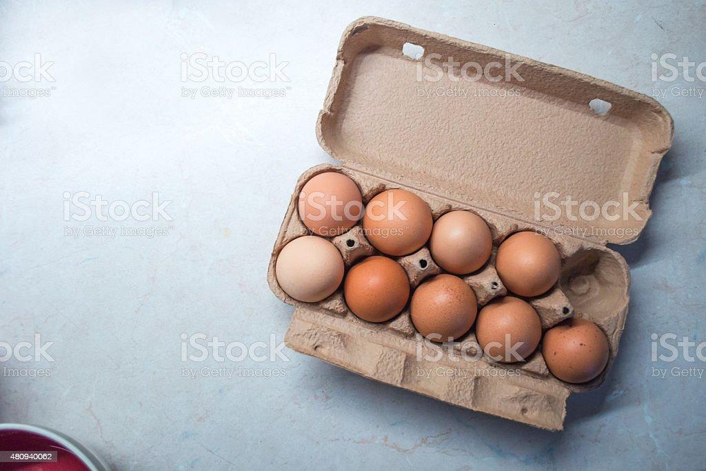 Nine Eggs in an Egg Box/Carton stock photo