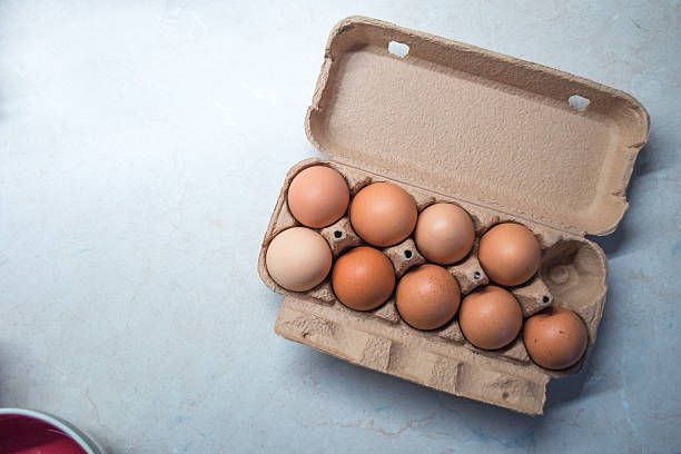 Nine Eggs in an Egg Box/Carton stock photo
