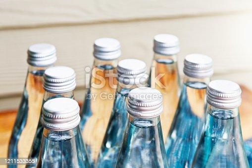 Nine sealed bottles of spring water.