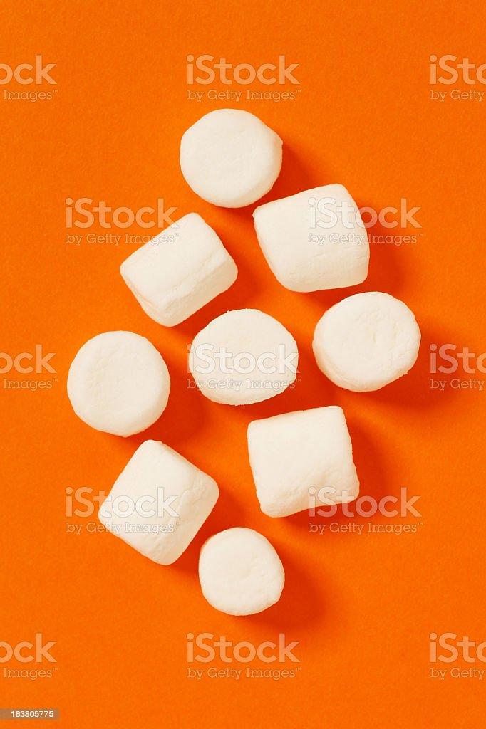 Nine marshmallows with orange background  royalty-free stock photo