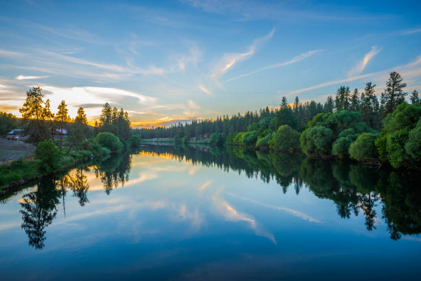 nine mile reservoir on spokane river at sunset - river stock photos and pictures