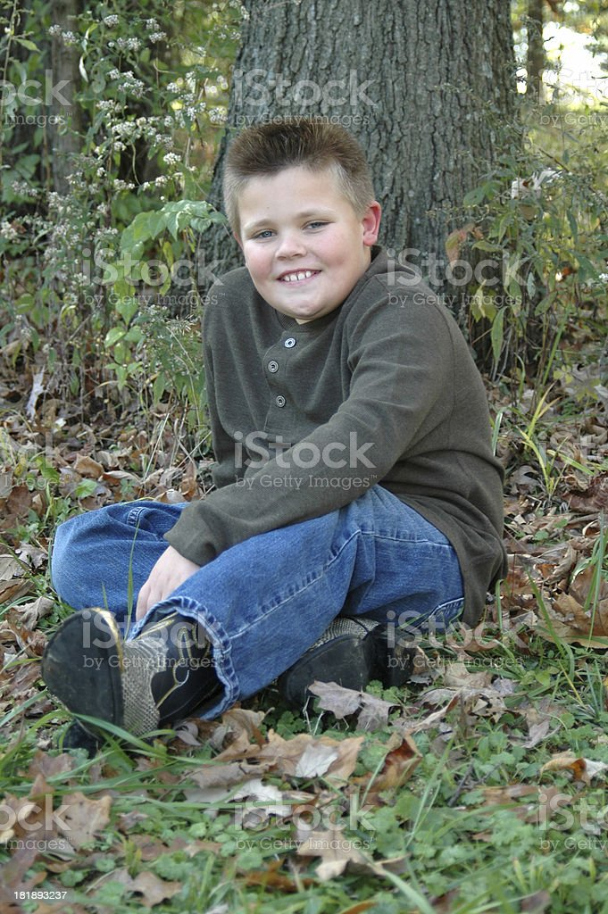 Nine Year Old Boy Posing in Leaves stock photo